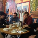 The seminary group and Lived Theology students discuss the day's schedule of events.